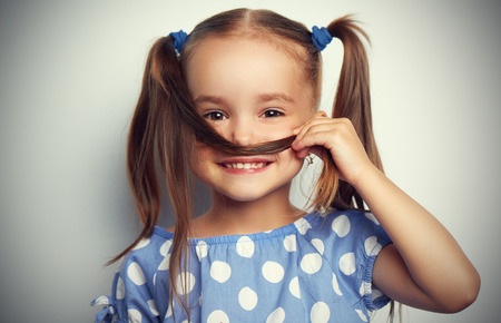 Photo for happy face funny child girl in a blue dress - Royalty Free Image