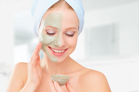 Foto per beautiful girl in the bathroom and mask for facial skin care - Immagine Royalty Free