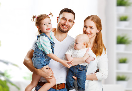 Photo for happy family mother, father and two children at home - Royalty Free Image