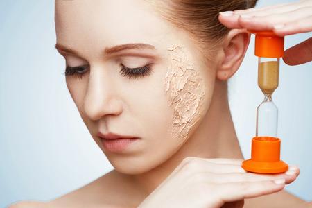 Foto de beauty concept rejuvenation, renewal, skin care and skin problems with hourglass - Imagen libre de derechos