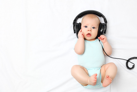 Foto de funny baby little boy in headphones - Imagen libre de derechos