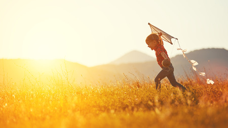 Photo pour happy child girl with a kite running on meadow in summer in nature - image libre de droit
