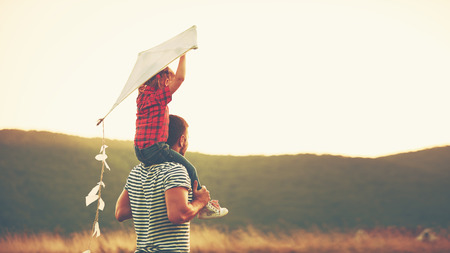 Photo for happy family father and child on meadow with a kite in the summer on the nature - Royalty Free Image