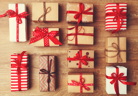 Photo for Christmas gifts presents on a wooden table desk - Royalty Free Image