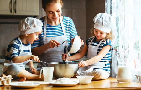 Photo pour happy family in the kitchen. mother and  children preparing the dough, bake cookies  - image libre de droit