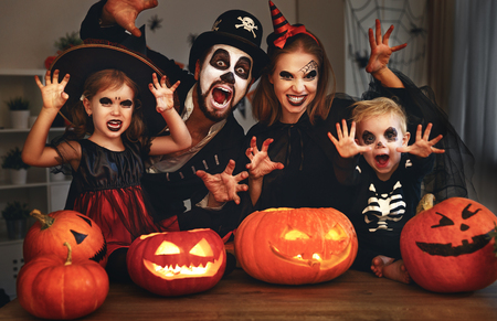 Foto per happy family mother father and children in costumes and makeup on a celebration of Halloween  - Immagine Royalty Free