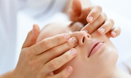 A beautiful girl enjoys massage and spa treatments