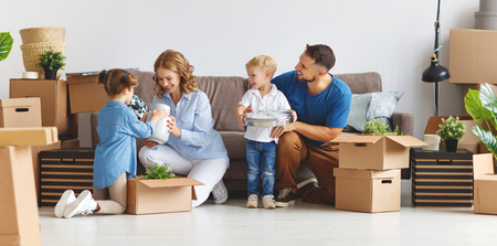 Photo pour happy family mother father and children move to a new apartment and unpack boxes - image libre de droit