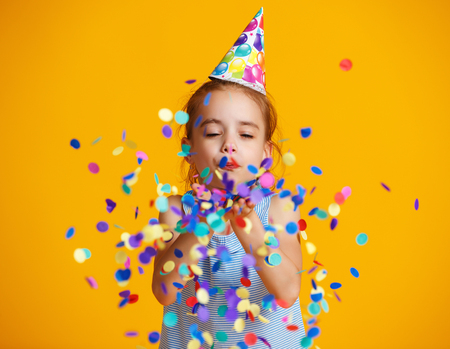 Photo pour happy birthday child girl with confetti on  colored yellow background - image libre de droit