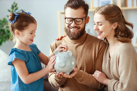 Photo for Family savings, budget planning, children's pocket money. Family with piggy Bank moneybox - Royalty Free Image
