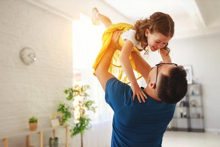 Foto de Father's day. Happy family daughter hugs his dad  on holiday - Imagen libre de derechos