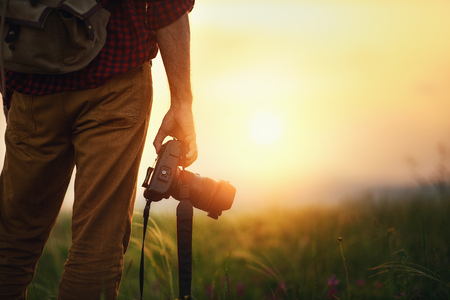 Photo for travel photographer. man traveler with camera in mountains at sunset in nature - Royalty Free Image