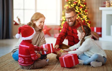 Photo for happy family parents and children open presents on Christmas morning - Royalty Free Image