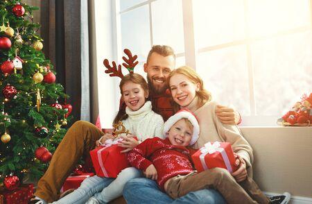 Photo pour happy family parents and children open presents on Christmas morning - image libre de droit