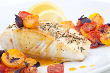 Pan fried halibut garnished with fennel seeds and spicy mustard sauce, served with fried cherry tomatoes salad with purple basil