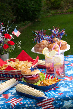 Cornbread, corn and burgers on picnic in patriotic theme