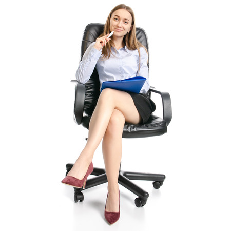 Foto de Business woman manager with folder sitting smiling on a chair on white background isolation - Imagen libre de derechos