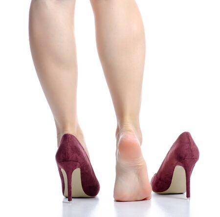 Photo pour Female legs red high heels pain beauty - image libre de droit