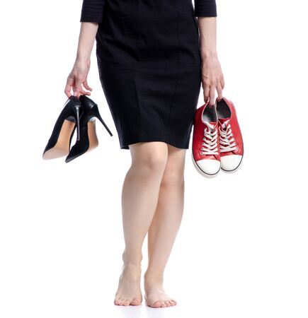 Photo pour Woman legs choice high heels or sneakers on white background isolation - image libre de droit