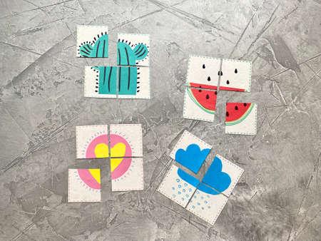 Photo pour The card with the application is cut into 4 parts, a childrens logic game. - image libre de droit