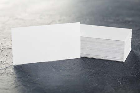 Photo pour White Blank business card on concrete background. Place for ID - image libre de droit