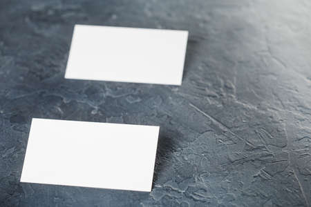 White Blank business card on concrete background. Place for ID
