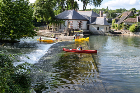 Azay-le-Rideau, France - July 23 2016: Red kayak, on the Indre river, in Azay-le-Rideau