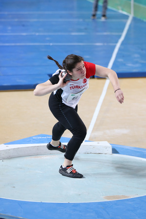 ISTANBUL, TURKEY - FEBRUARY 12, 2017: Athlete Sinem Yildirim shot putting during Balkan Junior Indoor Championships