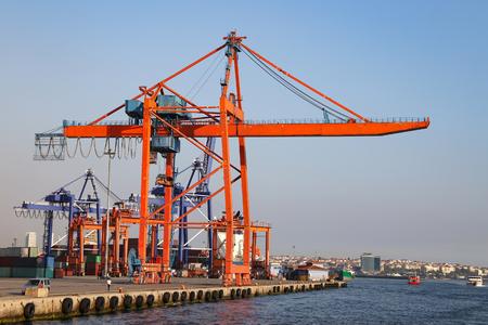 Photo for Orange Port Crane in a sea port - Royalty Free Image