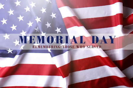 Photo pour Memorial day weekend translucent text written on ruffled USA flag background. United States of America stars & stripes patriot veteran remembrance symbol. Close up, copy space, top view. - image libre de droit