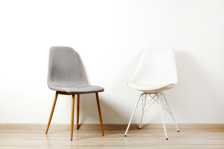 Photo pour Empy loft style chair over blank wall background wit a lot of copy space for text. Available job position, interview or negotiations concept. - image libre de droit