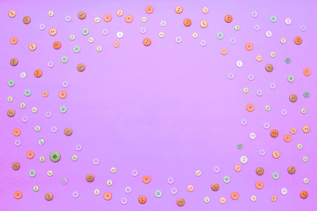 Background for text Ornamental frame of colored buttons. Top view Flat lay