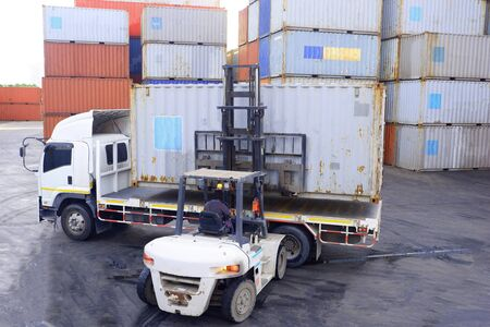 Photo for Container handlers Working in the container yard - Royalty Free Image