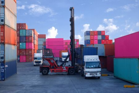 Photo for Container handlers Load the container into the truck - Royalty Free Image