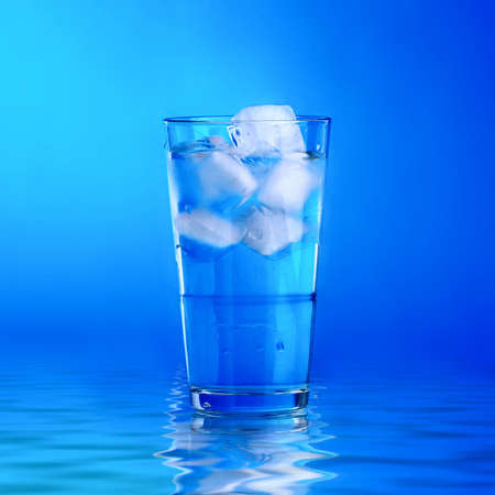 Glass of fresh water with cubes of ice