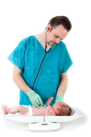 doctor and baby on a white background  Little baby on scales