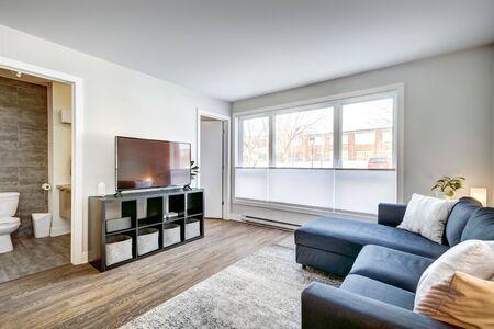 Foto de Full set of interior furnished apartment in modern condominium with patio, balcony, terrace in Montreal, Quebec, Canada - Imagen libre de derechos