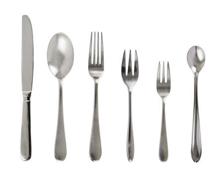 Set of steel metal table cutlery isolated over white background