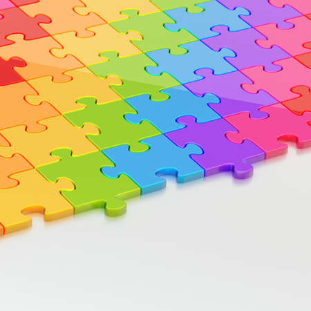 Reflective metal surface half-covered with the colorful glossy puzzle pieces as a copyspace background composition