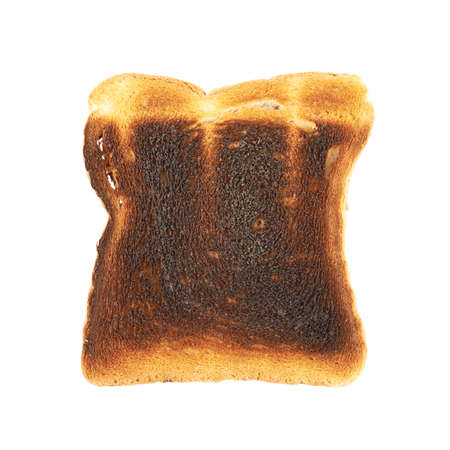 Burnt toast bread slice isolated over the white backrgound