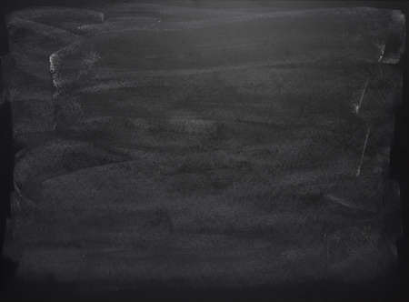 Foto de Black board with the traces of chalk over its surface as a background texture - Imagen libre de derechos