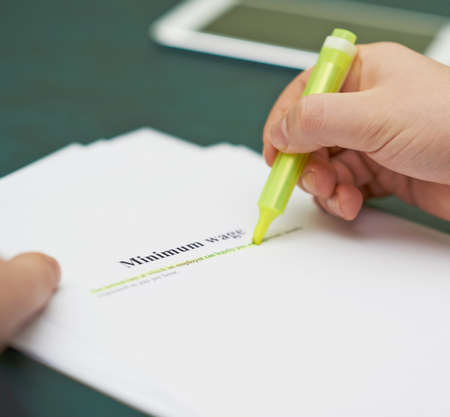 Marking words in a minimum wage definition, shallow depth of field composition