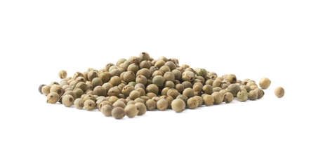 Pile of green peppercorn isolated over the white background