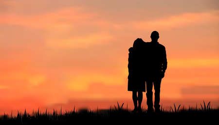 Illustration pour couples as a silhouette, walking on grass in the evening/morning against sunset/sunrise  - image libre de droit