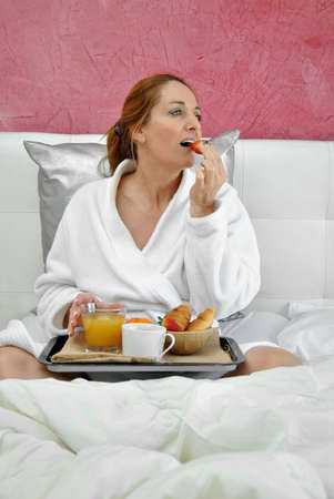 woman breakfast in her bed peacefully one day