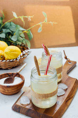Homemade lemonade on wooden board