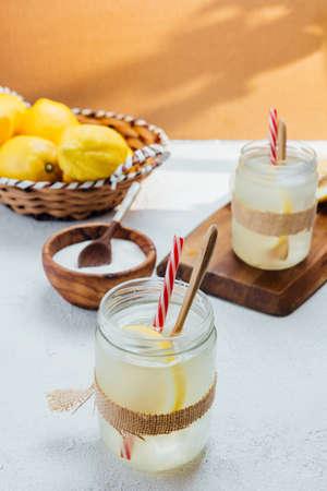 Homemade lemonade on wooden board