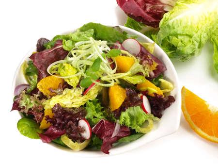 Photo pour Mixed Salad with Orange Isolated - image libre de droit