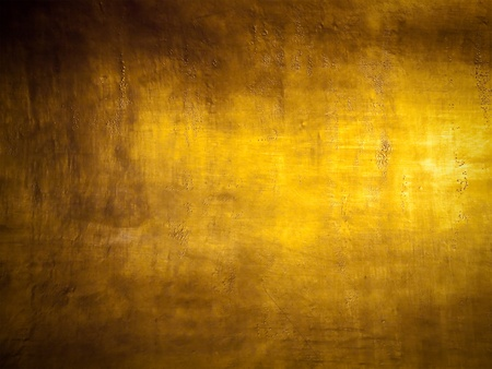 Antique golden grunge background with highlight texture