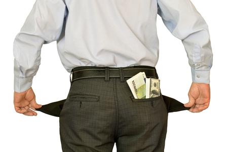 men businessman showing empty pockets hiding behind wads of money